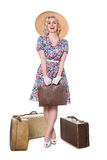 Beautiful retro blond standing with vintage suitcases, wearing s. Beautiful retro blond wearing sun hat, isolated on white Royalty Free Stock Photo