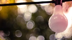 Beautiful retro bulb light lamp decor. Hanging decorative Christmas lights for an outdoor party. Blur bokeh background stock image