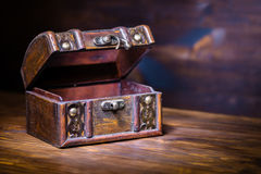 Beautiful retro chest with open lid on wooden background with pl Stock Photos