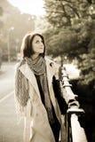 Beautiful retro girl in cloak. Near bridge Royalty Free Stock Image