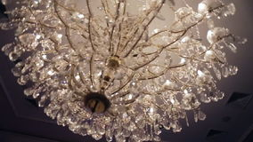 Beautiful retro luxury crystal strass chandelier isolated on a white wall of the restaurant. stock video