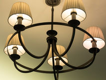 Beautiful retro luxury vintage chandelier hanging from ceiling. Classic lamp lighting Royalty Free Stock Photo