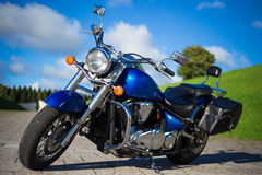 Beautiful retro motorcycle standing on the road Stock Photo