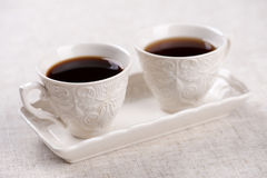 Beautiful retro pair of coffee cups, with coffee. Beautiful retro pair of coffee cups with coffee stock photo