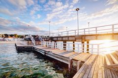 Beautiful retro pier at sunset. Gdansk Brzezno, Poland. Beautiful retro pier at sunset over Baltic sea. Gdansk Brzezno, Poland Stock Photography
