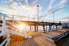 Beautiful retro pier at sunset. Gdansk Brzezno, Poland. Beautiful retro pier at sunset over Baltic sea. Gdansk Brzezno, Poland stock images