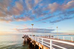 Beautiful retro pier at sunset. Gdansk Brzezno, Poland Royalty Free Stock Image