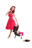 Beautiful retro pin-up girl with red polka dot dress Royalty Free Stock Photo