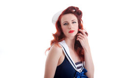 Beautiful retro pin-up girl in a sailor style dress Royalty Free Stock Images