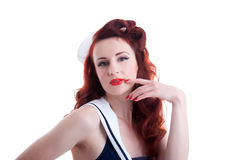 Beautiful retro pin-up girl in a sailor style dress Stock Photo