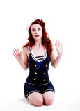 Beautiful retro pin-up girl in a sailor style dress Stock Photos
