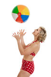 Beautiful Retro Pinup Girl with Beach Ball Royalty Free Stock Image