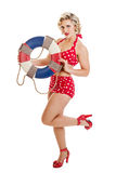 Beautiful Retro Pinup Girl with Life Preserver. Portrait of a beautiful mid 30s woman dressed in vintage retro polka dot bikini holding life preserver isolated Stock Photos