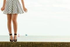 Beautiful retro style girl in polka dotted dress. Young beautiful woman retro styling wearing polka dot dress hihg heels outdoor royalty free stock photo