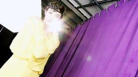 Beautiful retro style 20s female model posing in studio. Amazing model vintage style in studio stock video footage