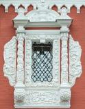 Beautiful retro window on red brick wall. Stock Photo