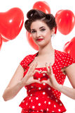 Beautiful retro woman celebrating Valentines Stock Photography