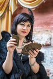 Beautiful retro woman holding playing cards royalty free stock photos