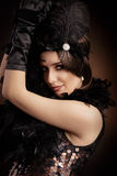 Beautiful retro woman in 20s style party outfit Royalty Free Stock Photo