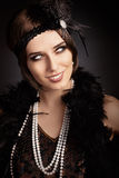 Beautiful retro woman in 20s style party outfit stock photos