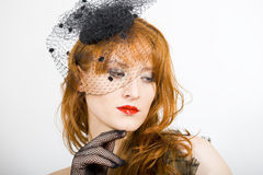 Beautiful retro woman with vintage hat and veil Royalty Free Stock Photo