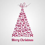 Beautiful ribbon Christmas tree with calligraphic bow. Stock Photos