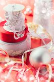 Beautiful ribbons for Christmas presents. On red background and some bokeh Stock Photos