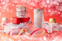 Beautiful ribbons for Christmas presents. On red background and some bokeh Stock Photography