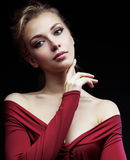Beautiful rich blond woman in elegant dress on Stock Photos