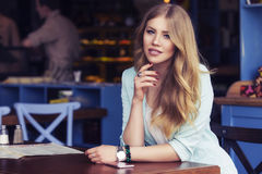 Beautiful rich casual blonde stylish fashion business woman with Royalty Free Stock Photo