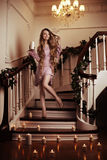 Beautiful rich woman on staircase with a candle Royalty Free Stock Image