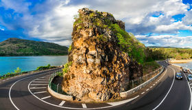 Beautiful ring road with rock - popular attraction in Mauritius Royalty Free Stock Photos
