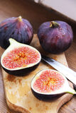 Beautiful ripe fresh pulpy figs on the table. Beautiful ripe fresh pulpy figs on the wooden table Stock Photography