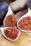 Beautiful ripe fresh pulpy figs on the table. Beautiful ripe fresh pulpy figs on the wooden table Royalty Free Stock Image