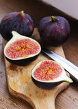 Beautiful ripe fresh pulpy figs on the table. Beautiful ripe fresh pulpy figs on the wooden table Royalty Free Stock Photography