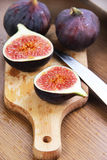 Beautiful ripe fresh pulpy figs on the table. Beautiful ripe fresh pulpy figs on the wooden table Royalty Free Stock Images