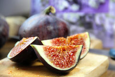 Beautiful ripe fresh pulpy figs on the table. Beautiful ripe fresh pulpy figs on the wooden table Royalty Free Stock Photo