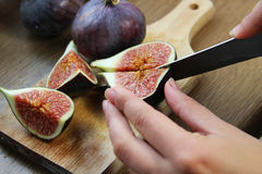 Beautiful ripe fresh pulpy figs on the table. Beautiful ripe fresh pulpy figs on the wooden table Stock Photo