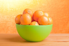 Beautiful ripe oranges on the table and a yellow orange backgrou. Beautiful ripe oranges on the table and yellow orange background Stock Photo