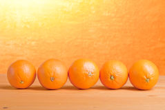 Beautiful ripe oranges on the table and a yellow orange backgrou. Beautiful ripe oranges on the table and yellow orange background Stock Photography