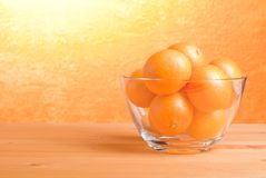 Beautiful ripe oranges on the table and a yellow orange backgrou. Beautiful ripe oranges on the table and yellow orange background Royalty Free Stock Photography