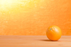 Beautiful ripe oranges on the table and a yellow orange backgrou. Nd Stock Photos
