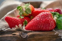 Beautiful ripe strawberries for sale on a tray in wooden containers. without plastic stock images