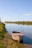 Beautiful River And Lonely Boat Stock Images