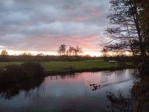 Beautiful river autumn sun set scene outside country plain lands Stock Photos