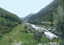 Beautiful river. With a nice blue sky ando green meadows Royalty Free Stock Image