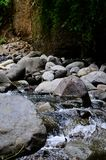 Beautiful River clear water flowing through stones and rocks Royalty Free Stock Image