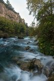 Beautiful river. Fast river in Fontaine-de-Vaucluse, France Royalty Free Stock Images