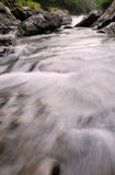 Beautiful river flow over the stone Stock Photos