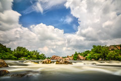 Beautiful river flow with sky stormy clouds,  moving water - lon Royalty Free Stock Image
